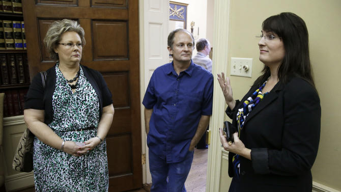 CORRECTS IDS - From left, Teresa Russell, Jeffrey Russell, and Tracy Barreiro, children of Janet Russell, talk about their mother in Nashville, Tenn. on Thursday, Oct. 5, 2012. Janet Russell is suffering from a deadly fungal meningitis that 39 people in six states have also contracted after getting steroid shots for back pain. Five have died. (AP Photo/Mark Humphrey)