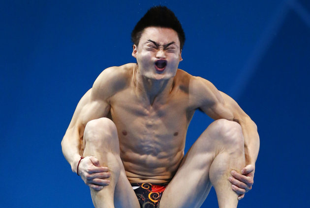 China's Qin Kai performs a dive during the men's 3m springboard preliminary round at the London 2012 Olympic Games at the Aquatics Centre