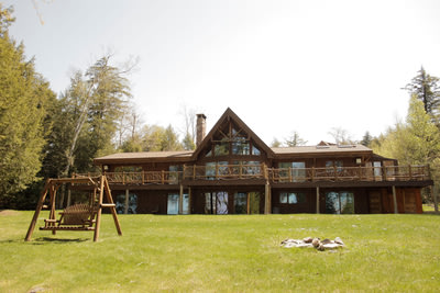 Up for Auction: A rare privately owned Adirondack waterfront property on Lower Saranac Lake.