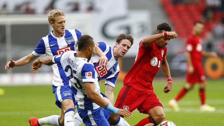 Herta BSC Berlin's van den Bergh, Brooks and Niemeyer challenge Bayer Leverkusen's Bellarabi during the German first division Bundesliga soccer match in Leverkusen