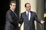 France's outgoing president Nicolas Sarkozy (left) welcomes his successor Francois Hollande at the Elysee Palace for the formal handover of power ceremony in Paris. Hollande has been sworn in as France's president, becoming the country's first Socialist leader in 17 years