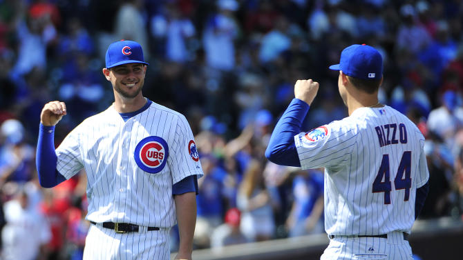 Arrieta, Rizzo lead Cubs over Cards in doubleheader opener