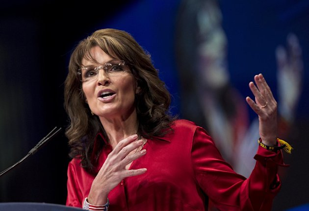 FILE - In this Saturday, Feb. 11, 2012 file photo, Sarah Palin, the GOP candidate for vice-president in 2008, and former Alaska governor, delivers the keynote address to activists from America's political right at the Conservative Political Action Conference (CPAC) in Washington. Palin is out as a Fox News Channel contributor. The network said Friday, Jan. 25, 2013, that it is parting ways with the 2008 Republican vice presidential candidate and former Alaska governor. (AP Photo/J. Scott Applewhite, File)