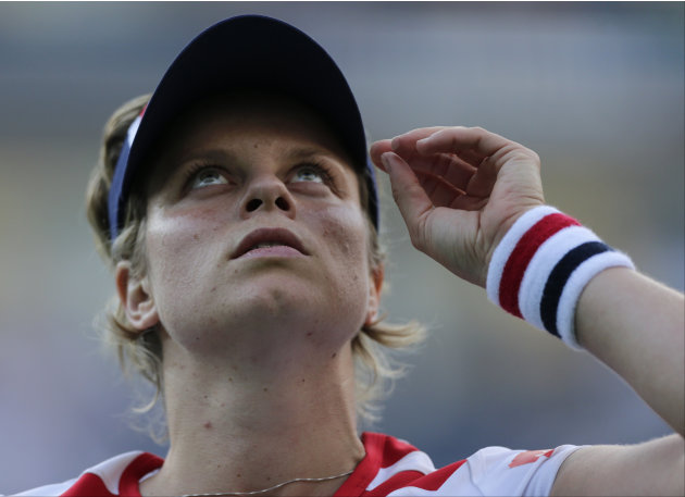 Kim Clijsters of Belgium looks up after losing to Laura Robson of Great Britain in the second round of play at the 2012 US Open tennis tournament,  Wednesday, Aug. 29, 2012, in New York. (AP Photo/Cha