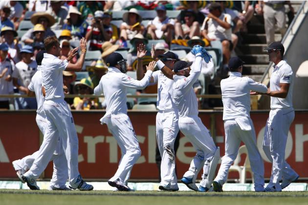 England's players celebrate with Kevin Pietersen after taking the wicket of Australia's George Bailey during the first day of the third Ashes cricket test at the WACA ground in Perth