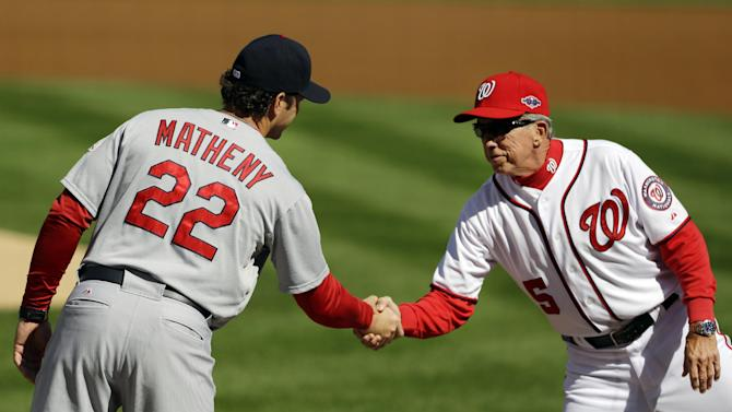 St. Louis Cardinals manager Mike Matheny, left, and Washington Nationals manager Davey Johnson shake hands before Game 3 of the National League division baseball series on Wednesday, Oct. 10, 2012, in Washington. (AP Photo/Pablo Martinez Monsivais)