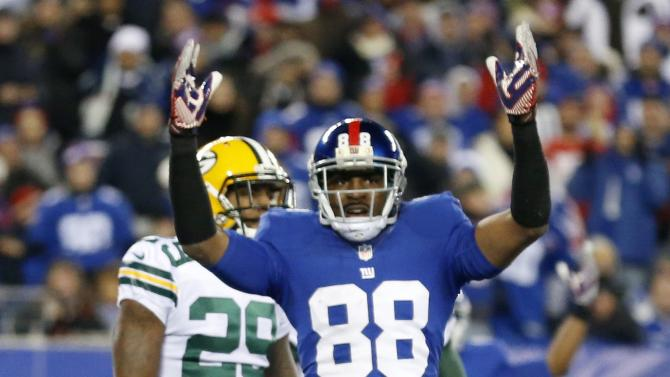 New York Giants wide receiver Hakeem Nicks (88) signals for a touchdown during the second half of an NFL football game against the Green Bay Packers, Sunday, Nov. 25, 2012, in East Rutherford, N.J. After further review quarterback Eli Manning's pass to Nicks was ruled a touchdown. (AP Photo/Julio Cortez)