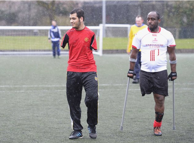 Ali Abbas, a victim of the Iraq war, plays football with members of the Limbless Association, in London