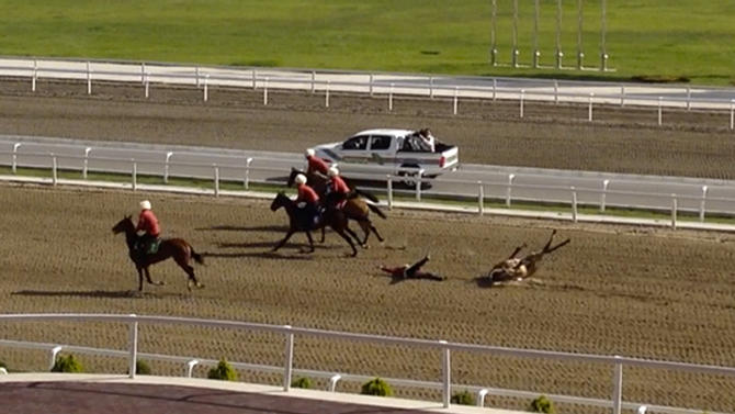 In this image taken Sunday, April 28, 2013 from video footage obtained by APTN, the fourth image taken from a series of 5, the horse carrying  a man believed to be Turkmen President Gurbanguli Berdymukhamedov falls after crossing the finish line at a horse race during celebrations of Turkmenistan's renowned desert racehorses   in capital Ashgabat, Turkmenistan. Berdymukhamedov did not appear to have been seriously injured and appeared before the crowd about a half-hour after the fall.  (AP Photo/via APTN)