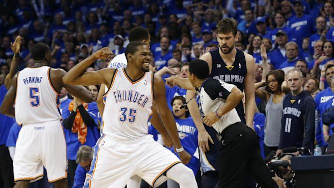 Oklahoma City Thunder forward Kevin Durant (35) reacts after Memphis Grizzlies guard Mike Conley, bottom right, was called out-of-bounds and the ball awarded to the Thunder in the fourth quarter of Game 1 of their Western Conference semifinal NBA basketball playoff series in Oklahoma City, Sunday, May 5, 2013. Oklahoma City won 93-91. (AP Photo/Sue Ogrocki)
