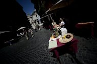 Tourists eat at a restaurant in Rome on May 4. Italians voted in local elections Sunday seen as a test of the country's political mood nearly six months after Prime Minister Mario Monti's government took over and imposed a biting austerity programme