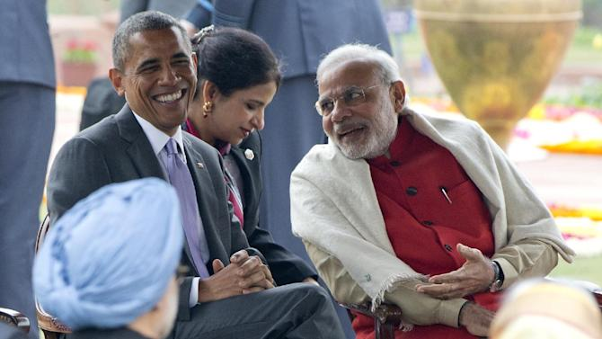 U.S. President Barack Obama, left, smiles as he talks with Indian Prime Minister Narendra Modi, right, during a reception in the Mughal Gardens of the Rashtrapati Bhavan presidential palace in New Delhi, India, Monday, Jan. 26, 2015. (AP Photo/Carolyn Kaster)