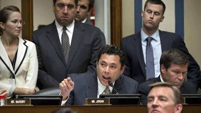 Rep. Jason Chaffetz, R-Utah, center, debates Rep. Stephen Lynch, D-Mass., as the House Oversight and Government Reform Committee considers a vote to hold Attorney General Eric Holder in contempt of Congress, on Capitol Hill in Washington, Wednesday, June 20, 2012.  (AP Photo/J. Scott Applewhite)