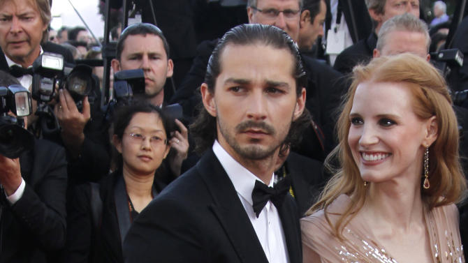 Actors Shia LaBeouf, left, and Jessica Chastain arrive for the screening of Lawless at the 65th international film festival, in Cannes, southern France, Saturday, May 19, 2012. (AP Photo/Joel Ryan)