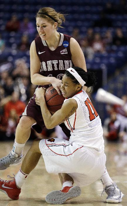 Montana's Kellie Cole, left, and Georgia's Tiaria Griffin struggle for possession of the ball in the second half during a first-round game in the women's NCAA college basketball tournament in Spokane, Wash., Saturday, March 23, 2013. Georgia won 70-50, advancing to play Iowa State in the second round on Monday. (AP Photo/Elaine Thompson)