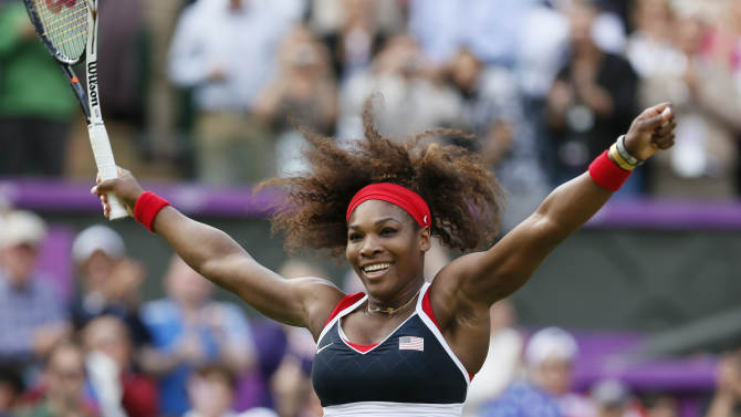 Serena Williams of the U.S. celebrates after winning the women's singles gold medal match against Russia's Sharapova at the All England Lawn Tennis Club during the London 2012 Olympic Games