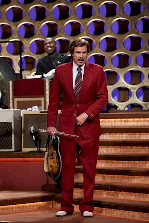 "In this March 28, 2012 photo released by Team Coco, Will Ferrell portrays broadcaster Ron Burgundy during an appearance on ""Conan,"" in Burbank, Calif.  Ferrell dressed as the popular character from ""Anchorman: The Legend of Ron Burgundy,"" and after performing a flute solo, he announced that there would be a sequel to the 2004 film. (AP Photo/Team Coco, Meghan Sinclair)"