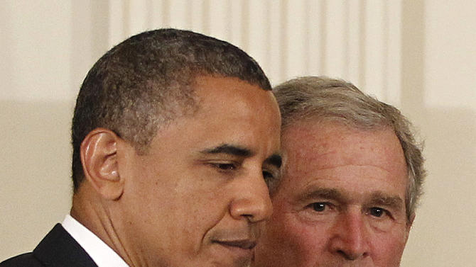President Barack Obama and former President George W. Bush take part in a ceremony in the East Room of the White House in Washington, Thursday, May 31, 2012, to unveil the Bush portrait.  (AP Photo/Pablo Martinez Monsivais)