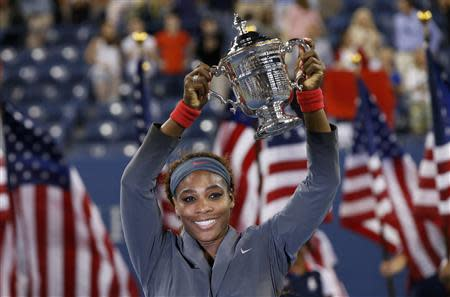 Serena Williams of the U.S. raises her trophy after defeating Azarenka of Belarus in their women's singles final match at the U.S. Open tennis championships in New York