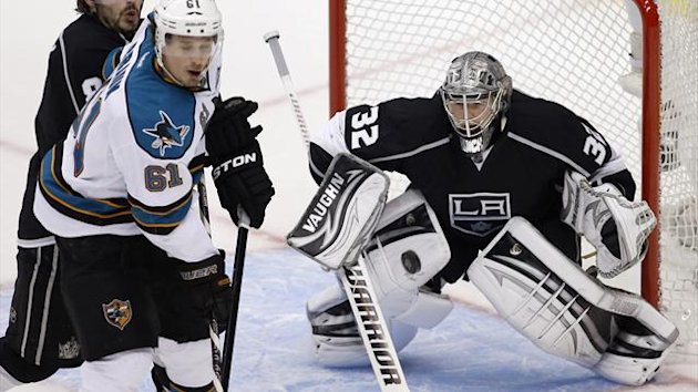 Los Angeles Kings goalie Jonathan Quick (32) makes a save on San Jose Sharks defenseman Justin Braun (61) in the 3rd period during Game 1 of their NHL Western Conference semifinal playoff hockey game in Los Angeles, California, May 14, 2013. (Reuters)