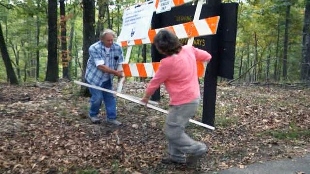 Locals move barricades to enter national park