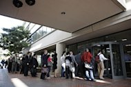 Individuals line up to enter the Robert F. Peckham United States Courthouse Building to watch Apple and Samsung face each other in federal district court for a patent infringement case in July 2012. The judge in the case reprimanded Samsung for releasing excluded evidence on Friday but rejected a bid by Apple to order a verdict in the case