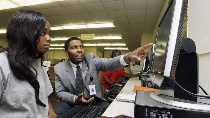 Renita Manny Williamson, a former Army reservist listens as Mississippi Department of Employment Security representative Tuskie Sanders. right, suggests ways to improve a job application letter at a state employment center in Jackson, Miss., Thursday, July 7, 2011. Unemployment rises to 9.2 pct. in June, as employers add only 18,000 jobs. (AP Photo/Rogelio V. Solis)