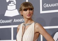 Singer Taylor Swift arrives at the 55th annual Grammy Awards in Los Angeles, California February 10, 2013. REUTERS/Mario Anzuoni