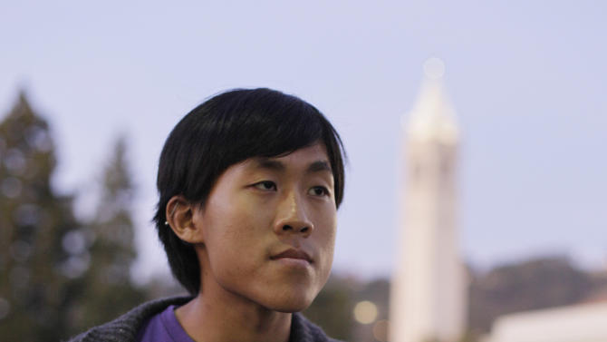 In this photo taken Nov. 16, 2011, Jesse Yeh poses on the University of California campus in Berkeley, Calif. He uses the library instead of buying textbooks. Yeh scrounges for free food and campus events and occasionally skips meals. He will not take out a student loan. (AP Photo/Eric Risberg)