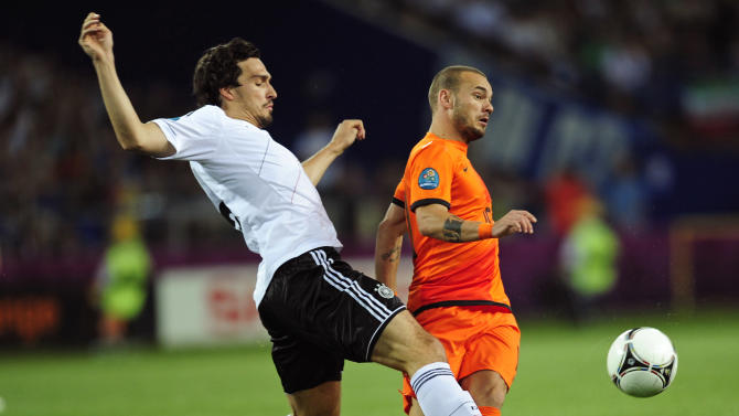 Wesley Sneijder from the Netherlands, right, is challenged by Germany's Mats Hummels during the Euro 2012 soccer championship Group B match between the Netherlands and Germany in Kharkiv, Ukraine, Wednesday, June 13, 2012. (AP Photo/Manu Fernandez)
