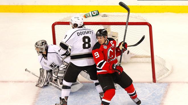 Drew Doughty #8 Of The Los Angeles Kings And Zach Parise #9 Of The New Jersey Devils Fight For Position In Front Of  Getty Images