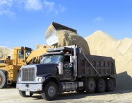 Municipal trucks fill up with salt, Wednesday, Feb. 6, 2013 in Portsmouth, N.H. as the Northeast prepares for a snowstorm later this week. The National Weather Service says the snow will start falling Thursday night, with the heaviest snowfall Friday afternoon and night. (AP Photo/Jim Cole)
