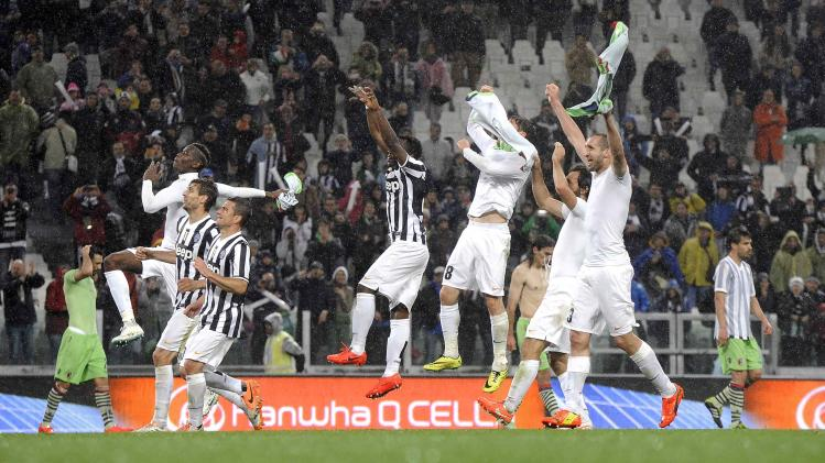 Juventus' players celebrate their win at the end of their Italian Serie A soccer match against Bologna in Turin