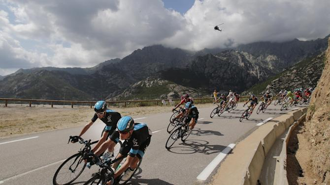 Vasili Kiryienka of Belarus, front right, and Christopher Froome of Britain, front left, speed down Vizzavona pass during the second stage of the Tour de France cycling race over 156 kilometers (97.5 miles) with start in Bastia and finish in Ajaccio, Corsica island, France, Sunday June 30, 2013. (AP Photo/Christophe Ena)