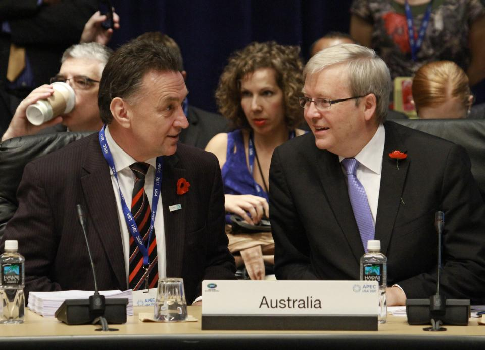 Australian Foreign Minister Kevin Rudd, right, talks with his country's Finance Minister Craig Emerson during an APEC ministerial meeting at the Asia-Pacific Economic Cooperation summit Friday, Nov. 11, 2011, in Honolulu. (AP Photo/J. David Ake)