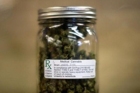 A jar of medical marijuana is displayed at the medical marijuana farmers market in Los Angeles