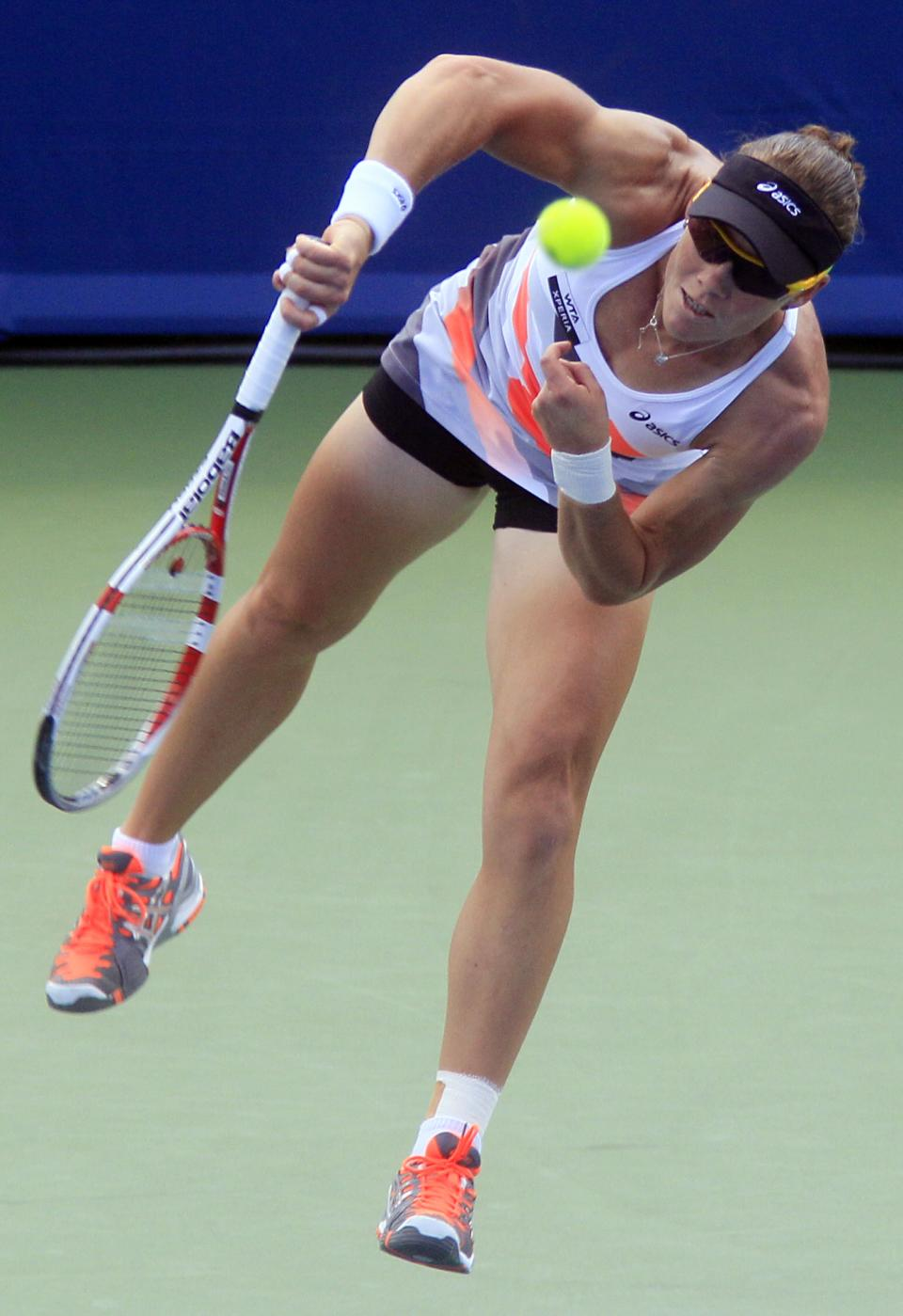 Samantha Stosur, from Australia, serves against Venus Williams during a quarterfinals match at the Western & Southern Open tennis tournament, Friday, Aug. 17, 2012, in Mason, Ohio. (AP Photo/Al Behrman)