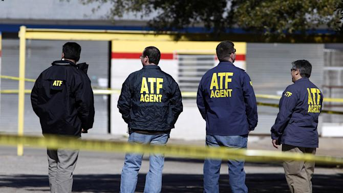 ATF agents stand close to the area where an Assistant District Attorney was shot and killed on Thursday, Jan. 31, 2013 in downtown Kaufman, Texas. Kaufman County Assistant District Attorney Mark Hasse was shot and killed early Thursday morning as he was walking from his car to the courthouse. (AP Photo/The Dallas Morning News, David Woo)