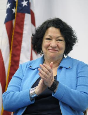 "Supreme Court Associate Justice Sonia Sotomayor is introduced to speak at the University of the District of Columbia's David Clarke School of Law ""Joseph Rauh, Jr., Conversation"" in Washington, Monday, April 2, 2012. (AP Photo/Cliff Owen)"