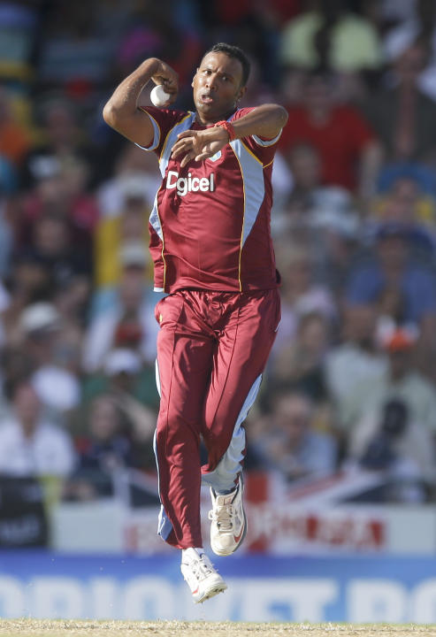 West Indies' Samuel Badree bowls during the first T20 International cricket match against England at the Kensington Oval in Bridgetown, Barbados, Sunday, March 9, 2014. (AP Photo/Ricardo Mazalan)