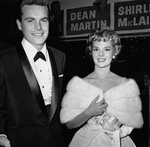 """Robert Wagner and wife Natalie Wood arrive for the premiere of """"some came running"""" in Hollywood, Los Angleles on December 18th, 1958."""