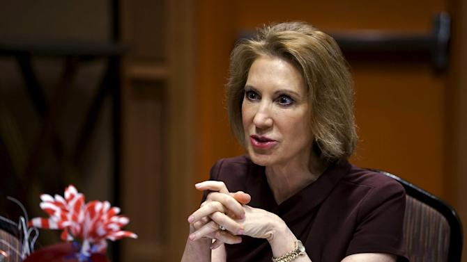 Fiorina, Republican presidential candidate, talks with an attendee at the Southern Republican Leadership Conference in Oklahoma City