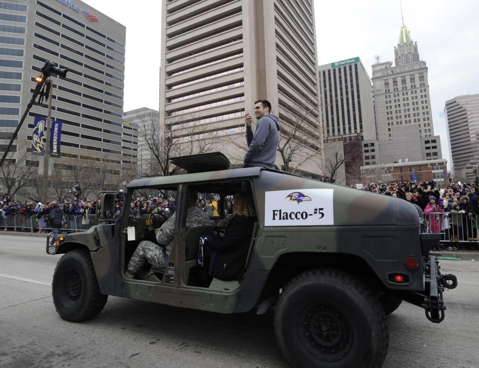 Baltimore Ravens quarterback and Super Bowl MVP Joe Flacco rides in a Humvee during the Ravens victory parade Tuesday, Feb. 5, 2013, in Baltimore. The Ravens defeated the San Francisco 49ers in NFL football's Super Bowl XLVII 34-31 on Sunday. (AP Photo/Gail Burton)