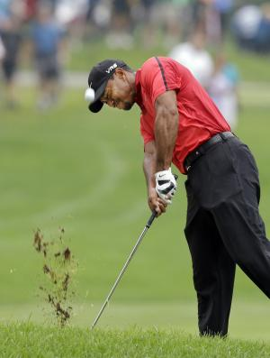 Woods' future uncertain with more back pain