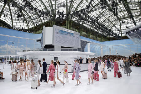 All aboard Chanel Airways as Lagerfeld's imagination takes flight