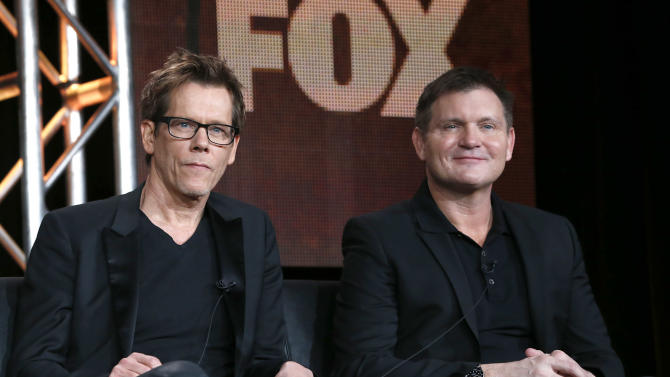 "CORRECTS DAY AND DATE - Kevin Bacon and Executive Producer/Creator Kevin Williamson from ""The Following"" attend the Fox Winter TCA Tour at the Langham Huntington Hotel on Tuesday, Jan. 8, 2013, in Pasadena, Calif. (Photo by Todd Williamson/Invision/AP)"