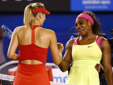 Williams of the U.S. shakes hands with Sharapova of Russia after defeating her in their women's singles final match at the Australian Open 2015 tennis tournament in Melbourne