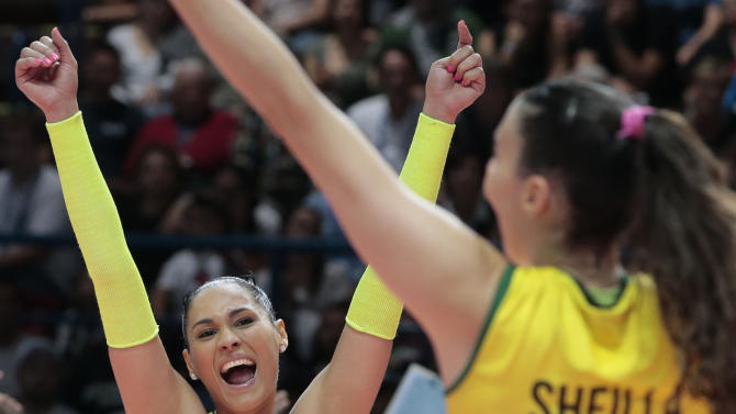 Brazil's Jaqueline Pereira De Carvalho Endres, left, and teammate Sheilla Castro De Paula Blassioli celebrate after winning the women's Volleyball World Championships third place final match against Italy in Milan, Italy, Sunday, Oct. 12, 2014. (AP Photo/Emilio Andreoli)