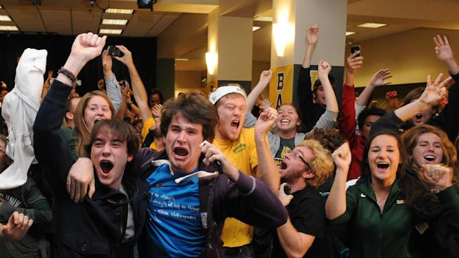 Baylor University students react after quarterback Robert Griffin III won the Heisman Trophy award during a watch party on campus, Saturday, Dec. 10, 2011, in Waco, Texas. (AP Photo/Waco Tribune Herald, Rod Aydelotte)