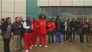 Retired U.S. NBA basketball player Dennis Rodman (6th R) poses with his team members after arriving in Pyongyang in this still image taken from video, February 26, 2013. REUTERS/KCNA for REUTERS TV